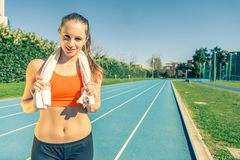 Woman running on a track Royalty Free Stock Photos