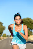 Woman running and training hard Royalty Free Stock Images