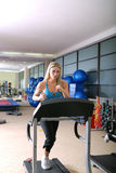 Woman running on treadmill Stock Images