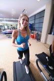 Woman running on treadmill stock photos
