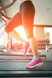 Woman running on treadmill Royalty Free Stock Photo
