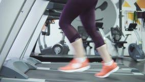 Woman running on a treadmill stock video