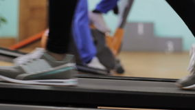 Woman running on a treadmill stock footage