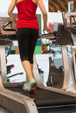 Woman Running on a Treadmill in Fitness Club Stock Images