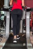 Woman Running on a Treadmill in Fitness Club Stock Image