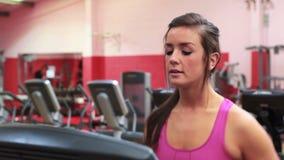 Woman running on a treadmill stock video footage