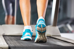 Woman running on treadmill. Stock Photos