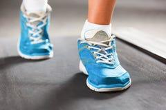 Woman running on treadmill. Royalty Free Stock Photo