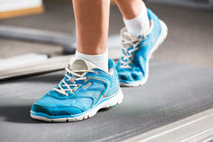 Woman running on treadmill. Royalty Free Stock Photos