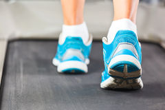 Woman running on treadmill. Royalty Free Stock Images