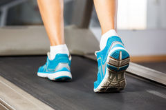 Woman running on treadmill. Stock Photo