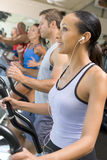 Woman Running On Treadmill At Gym Royalty Free Stock Photo