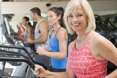 Woman Running On Treadmill At Gym Stock Image