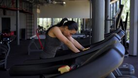 Woman running treadmill gym athlete jogging indoor weight loss workout jogger run cardio training