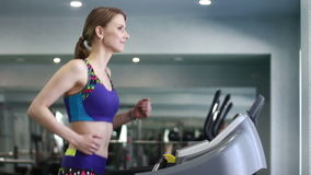 Woman  running on a treadmill in gym stock video footage