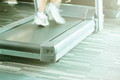 Woman running with treadmill with motion of speed with yellow li Stock Image