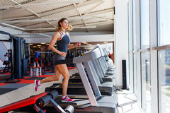 Woman running on treadmill Stock Photo