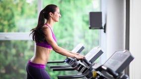Woman running on treadmill. Sports training 5x slow motion stock video footage