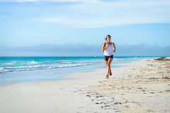 Woman running at tropical beach Stock Photography