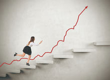 Woman running up concrete stairs Royalty Free Stock Photos