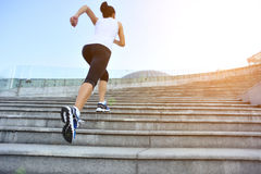 Woman running up on stone stairs. Healthy sports asian woman running up on stone stairs Stock Photo