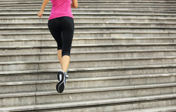 Woman running up on mountain stairs Royalty Free Stock Photos