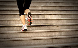 Woman running up on mountain stairs Royalty Free Stock Image