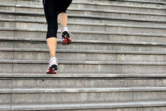 Woman running up on mountain stairs Stock Photography