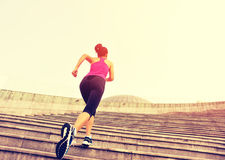 Woman running up on stone stairs Stock Photo