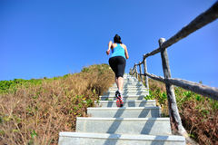 Woman running up on mountain Stock Image