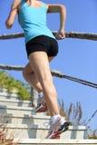 Woman running up on mountain Stock Photos