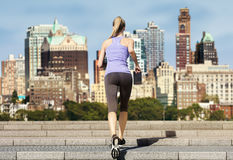 Woman running up stairs skyline Royalty Free Stock Images