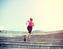 Woman running up on stone stairs Stock Photos