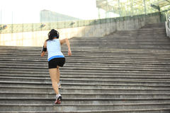 Woman running up on stone stairs Stock Images