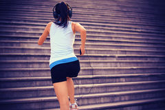 Woman running up on stone stairs Royalty Free Stock Image