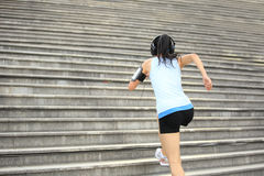 Woman running up on stone stairs Royalty Free Stock Photos