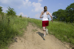 Woman running uphill royalty free stock photo