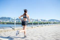 Woman running at urban city Stock Images