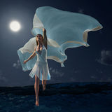Woman running on the waves Royalty Free Stock Photo