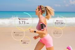 Free Woman Running, Wearable Tech Concept Stock Photography - 113631922