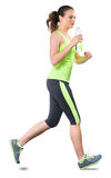 Woman Running on White. Young Woman Running on White Royalty Free Stock Images
