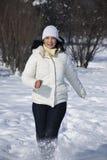 Woman running in winter stock photos
