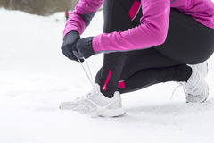 Woman running in winter Royalty Free Stock Photo