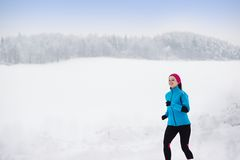 Woman running in winter Stock Photography
