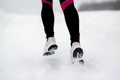 Woman running in winter Royalty Free Stock Images