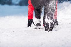 Woman running in winter Stock Image