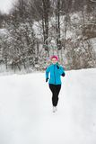 Woman running in winter Royalty Free Stock Photos