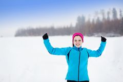 Woman running in winter stock images