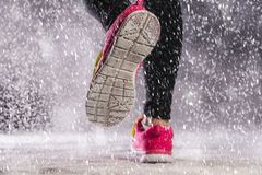 Woman running in winter Royalty Free Stock Image