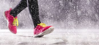 Woman running in winter Stock Photos
